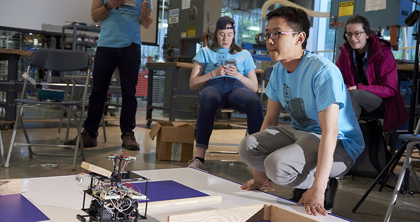 Student teams participate in the annual Design Competition by building semi-autonomous robots to compete in a round-robin style tournament based on the classic board game, Battleship.