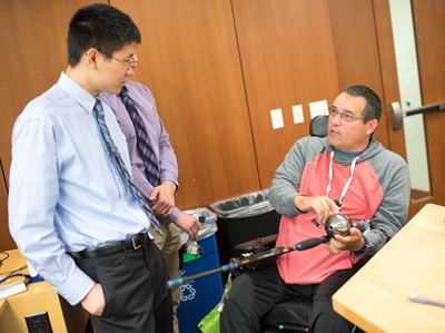 A DTC student works with a patient at the Rehabilitation Institute of Chicago.
